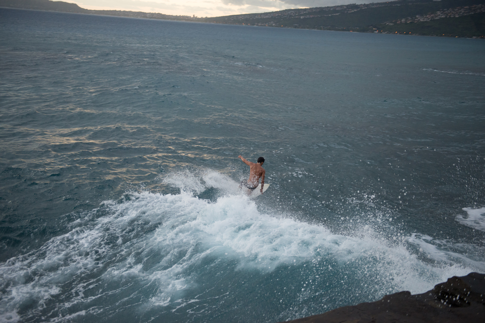 surfer at China Walls Oahu