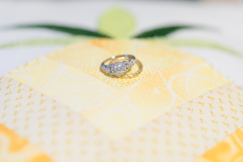 Wedding rings on quilted pineapple pillow