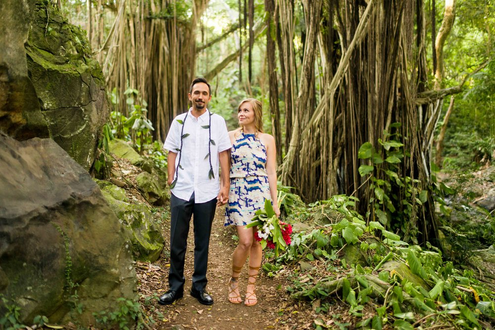 OAHU ENGAGEMENT PHOTOGRAPHY IN NUUANU FOREST.  FRESH MAILE LEI FOR HIM, VIBRANT RED HELICONIA FOR HER.