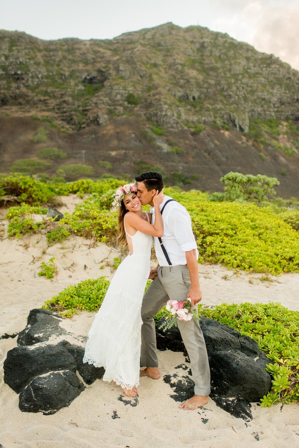 OAHU WEDDING PHOTOGRAPHER. BRIDAL PORTRAIT WITH PINK AND BLUSH HAKU LEI.