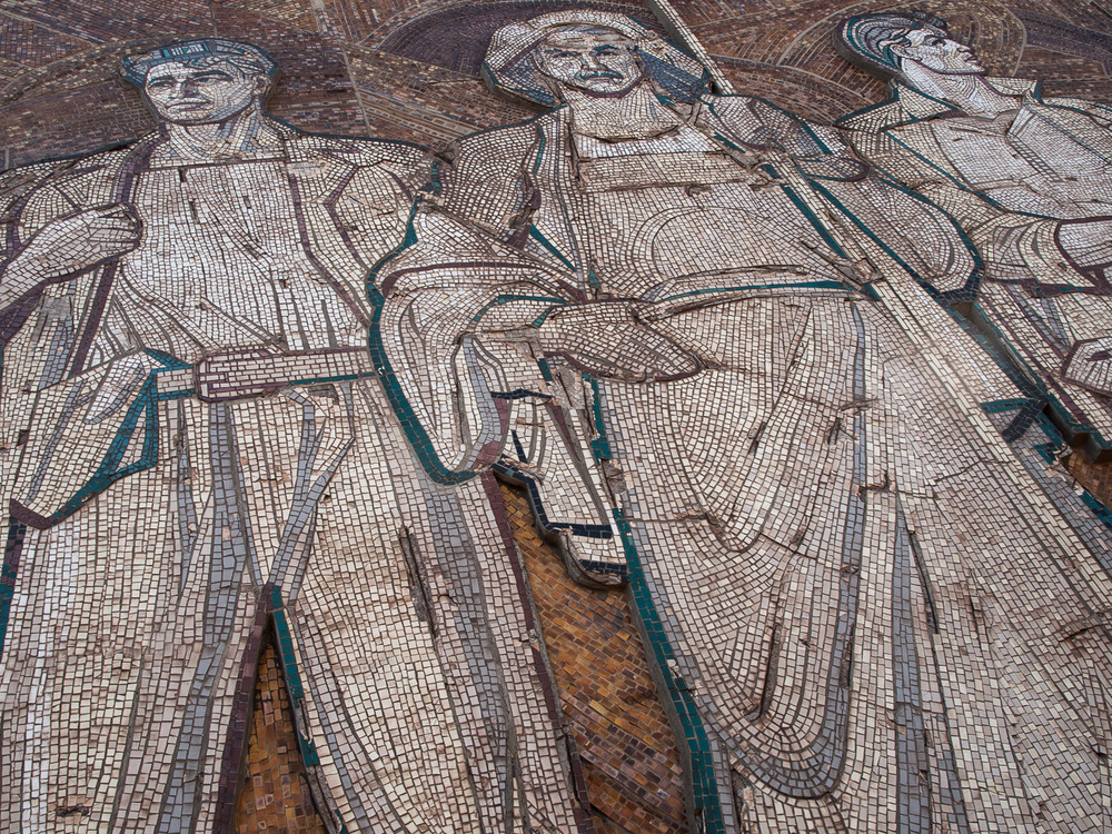 A Soviet­-era mosaic outside the Kryvorizhstal plant in the city of Kryvyi Rih. The city is a major centre of steel production and iron ore mining.
