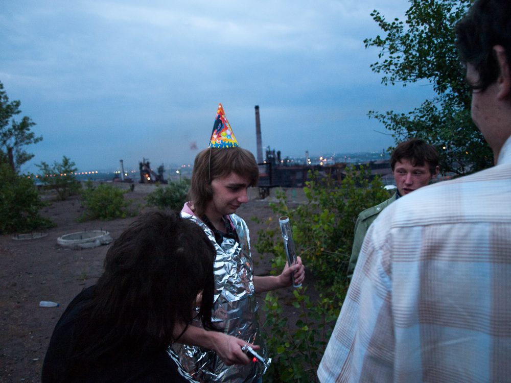 Young people celebrate a birthday on a factory roof in the industrial zone of Dnipropetrovsk, east Ukraine.