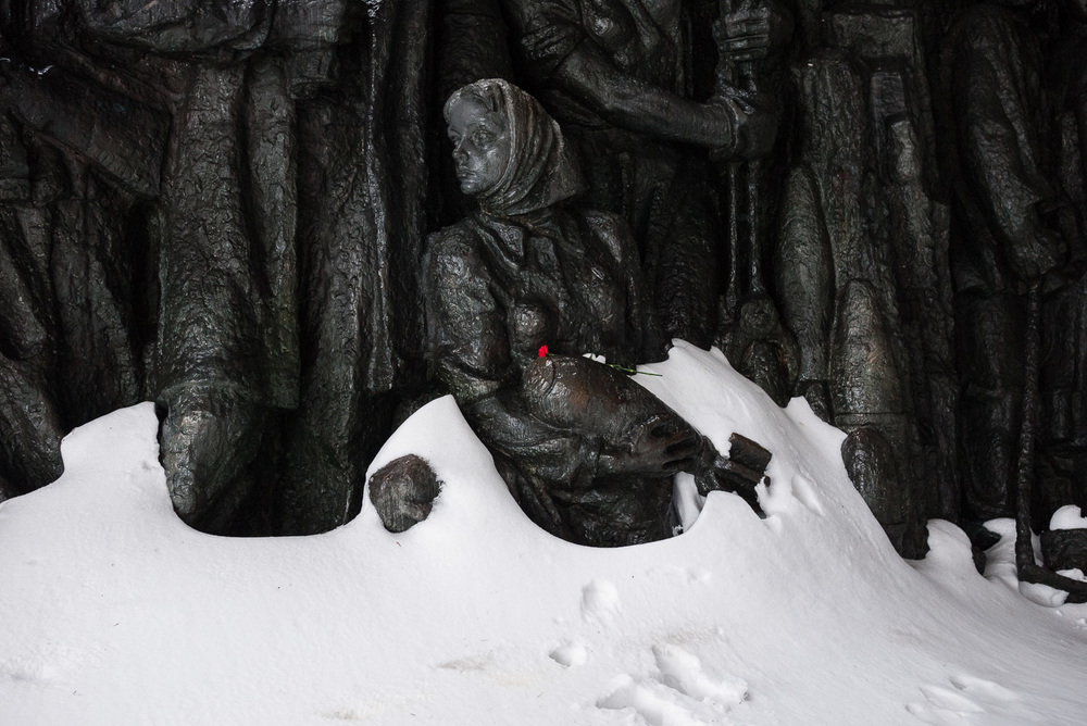 A flower is left on a Soviet­-era monument to those who defended Kiev during the Second World War in the city's Museum of the Great Patriotic War.