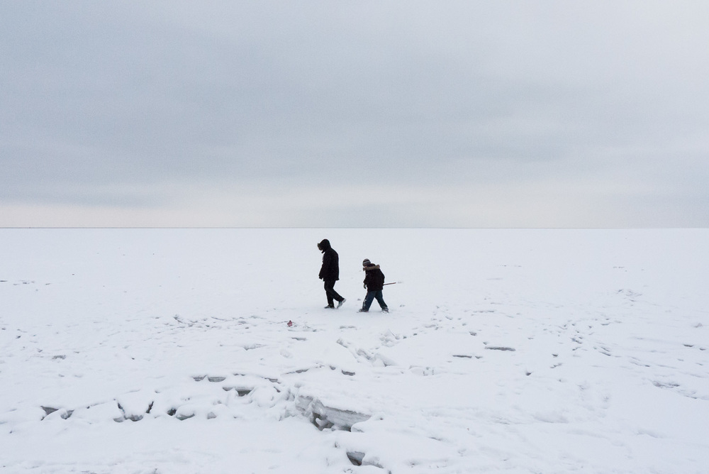 Boys walk on the frozen Azov Sea near the city of Mariupol.