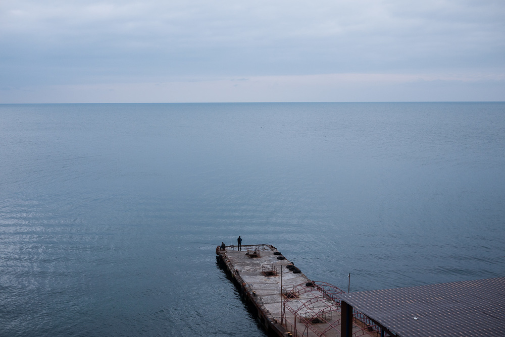 Men fishing in the Black Sea near Yalta, Crimea.