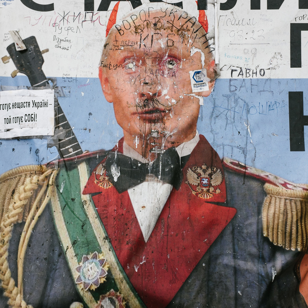 A defaced poster of Russian president Vladimir Putin on Kiev's Independence Square, April 2014.