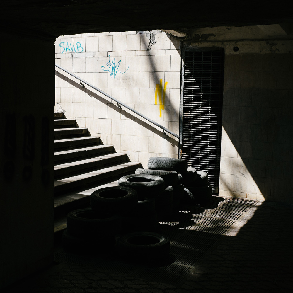 Tires in an underpass underneath Independence Square.
