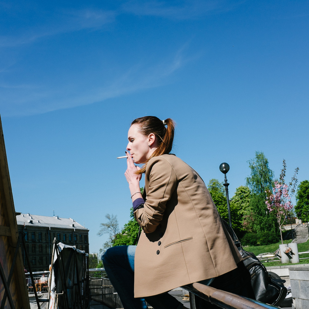 A woman smokes overlooking Kiev's Independence Square.