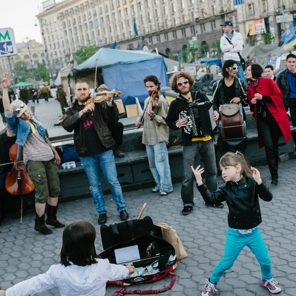 Girls dance to a street band playing to crowds on Kiev's Independence Square, April 2014.