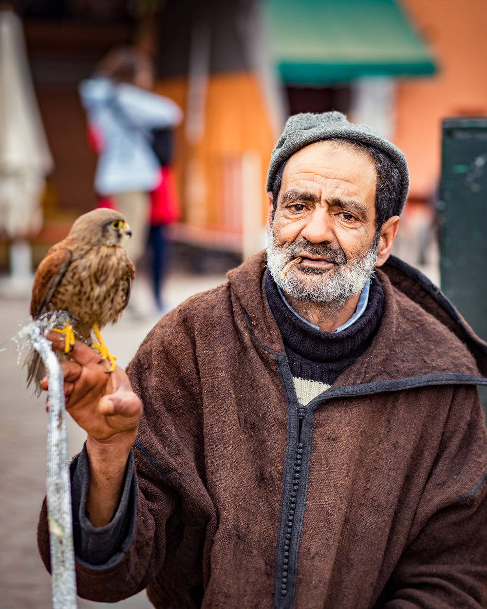 Local man posing for photos with his bird, for tips only of course.