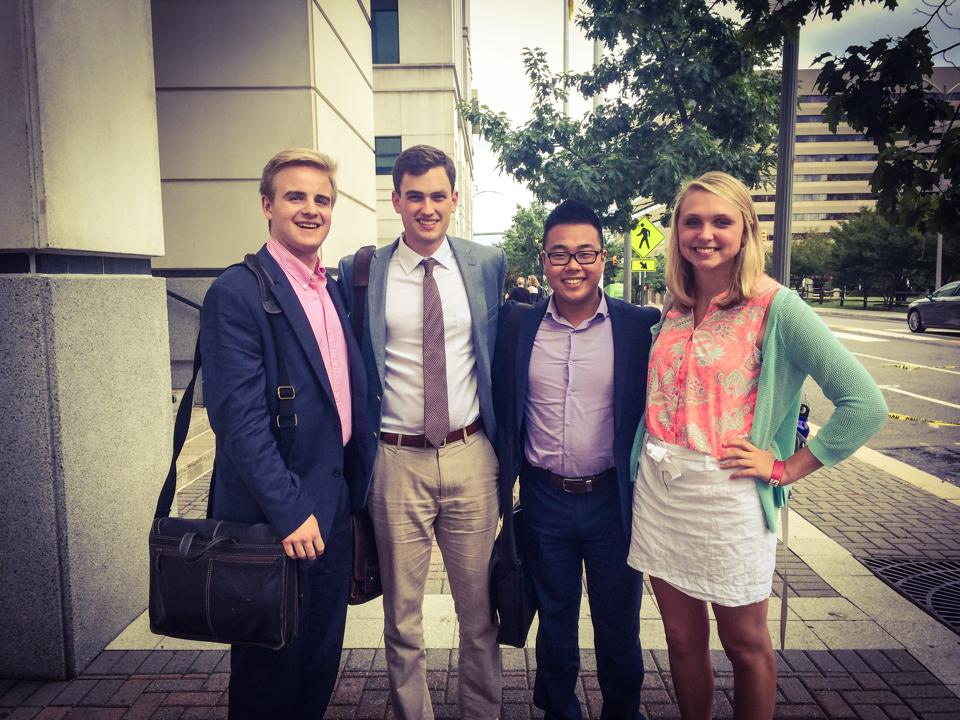 From Left to Right: Alex Titus and Jake Gram taking a sharp photograph outside of the Charles Koch Institute in Washington, D.C. with fellow interns.