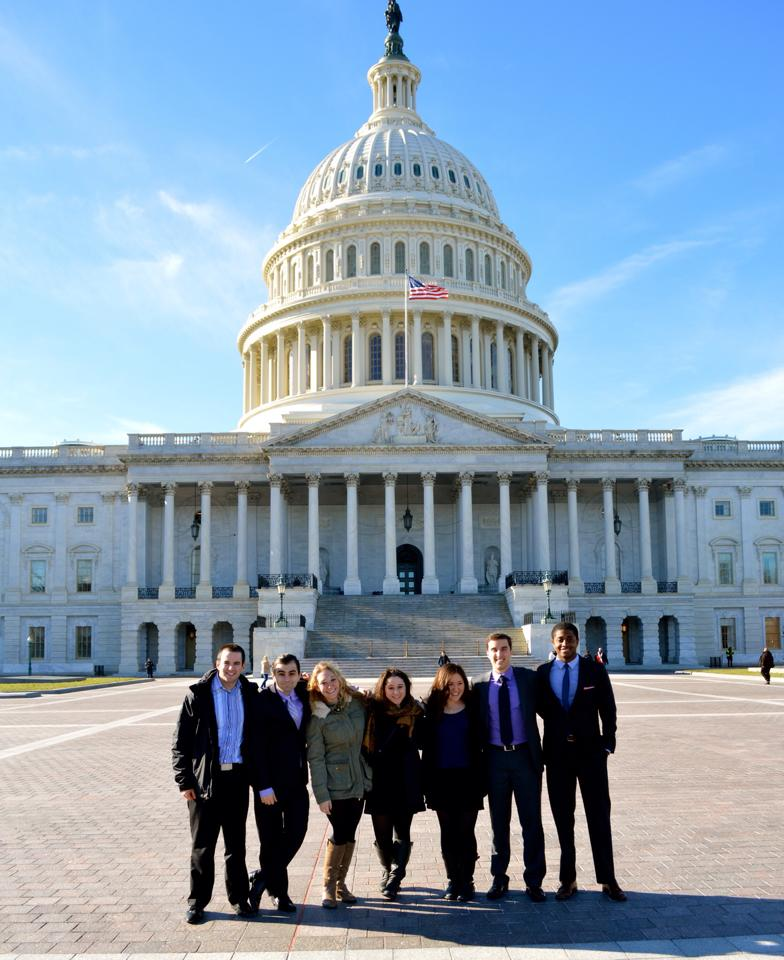 Marshall Kosloff pictured on the far right with colleagues in front of the Capitol Building.