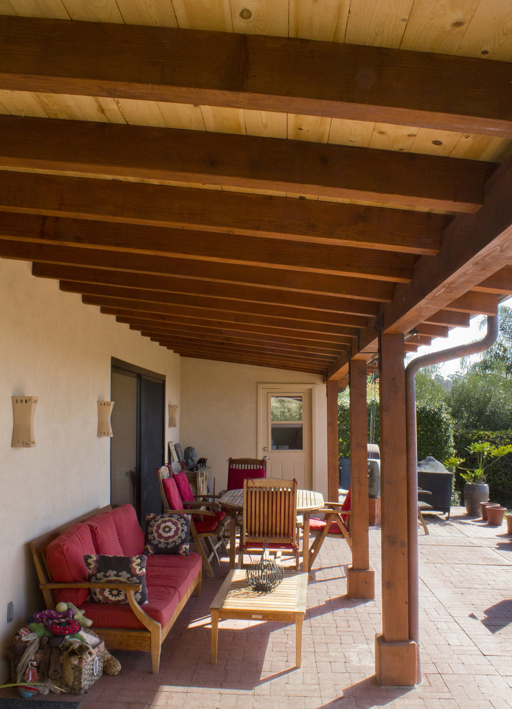 Expansive back patio with the continued exposed beams theme provides a space for entertaining and relaxing.