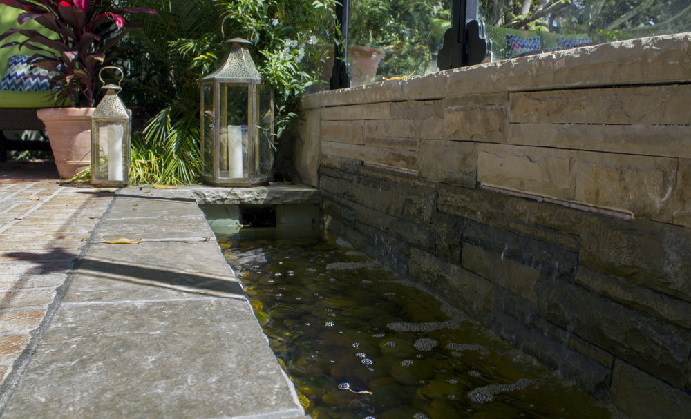 Soothing running water creating a tranquil patio space for enhanced relaxation.