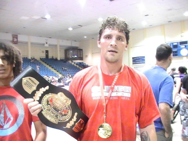 Joey Hughes - entered his first grappling tournament ever and as a blue belt and won the Grappler's Quest No-Gi Super Heavy Advanced National Championship Belt in 2010.