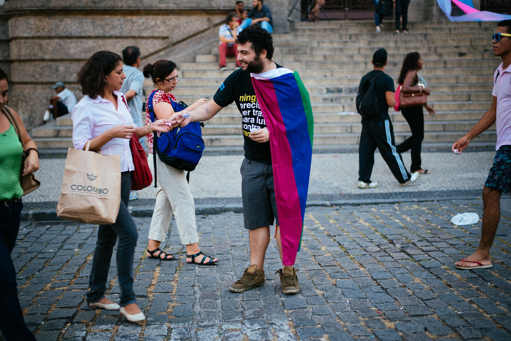 Thiago Bassi, 29, hands outs fliers to raise awareness of transsexual rights in front of Rio de Janeiro city hall on January 29th, 2015. Bassi recalled being moved after learning how many transsexuals have been killed in Brazil recently as reason for his newfound activism.