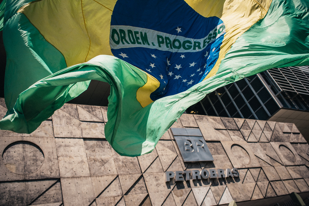 The Brazilian flag waves in front of Petrobras headquarters in Rio de Janeiro, Brazil. In recent weeks, the company has been embroiled in one of the largest corruption scandals in the nations history. 03-13-2015.