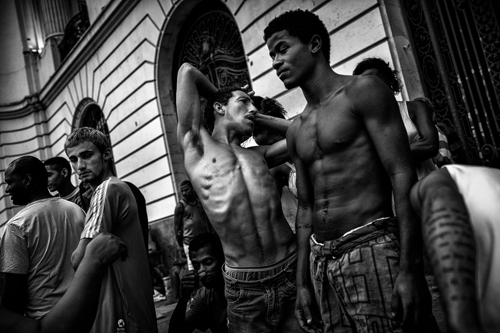 Hiogo, 23, (center) emaciated. Hiogo is a day laborer working construction and in recent months has struggled to find work.