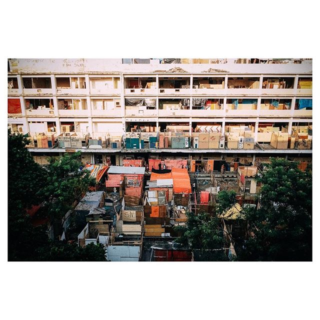 """Squatters 1 - 2013  One of the largest office complexes in Brazil belonging to Telebrás, the former state run telecom in Brazil, being occupied by squatters. In the late 1990's, Telebrás was privatized and the property abandoned. Politicians promised for years to remodel the old office complex into public housing. Fed up with empty promises, in 2013 working people took it upon themselves to make those promises a reality. After nearly two weeks of occupation, they were violently forced out by the state. These photographs, I think, are a """"surplus-aesthetic"""" of their experience. Meaning that materially, nothing really changed for these people as a result of either their protest or the images made. Except to say that their experiences were, I think, faithfully registered and that the photographs are just a sort of material afterglow of the emotions that these people experienced over those two weeks."""