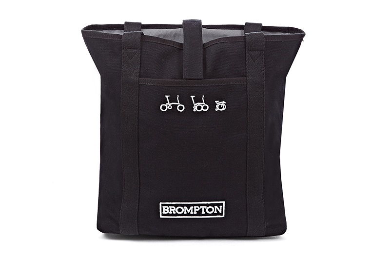 tote bag black  -Teflon-coated cotton canvas -Quick-access Velcro fastening -Internal zip pocket -reflective rain cover  -280 x 300 x 110mm  Black, Turkish Green or Cherry Blossom finish