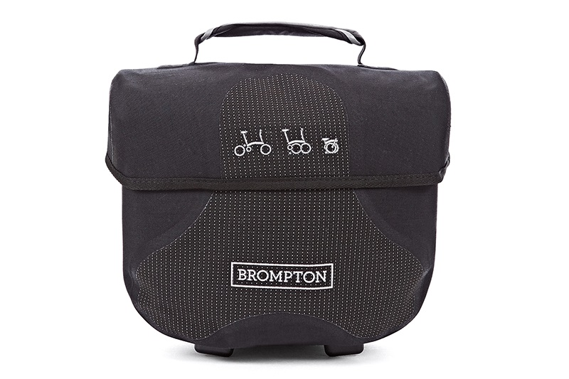 Mini o-bag  -Available in reflective material -Water-resistant -Internal zip pocket -Shoulder strap  -7 Litres