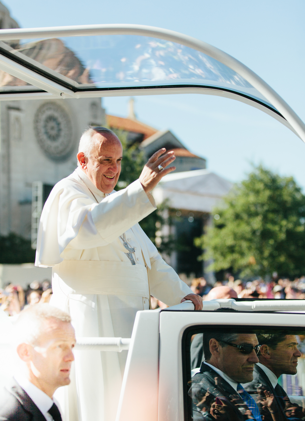 Pope Francis in his vehicle with Secret Service