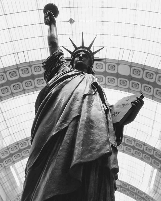 I'm here at the Musée d'Orsay in Paris where this replica of the Statue of Liberty stands at the entrance. I loved learning a bit more of the full statue's story: ⠀⠀⠀⠀⠀⠀⠀⠀⠀ For a few weeks in 1884, you could walk through the heart of Paris and see the Statue of Liberty — the full-sized gift that now stands tall in New York City. It was being built here in Paris before being packed into 200 crates to be shipped across the Atlantic to the 100 year-old nation. ⠀⠀⠀⠀⠀⠀⠀⠀⠀ Just a few years later, the Statue of Liberty was inaugurated and quickly became the welcoming beacon for generations of immigrants arriving by boat in the hopes of building a better life.