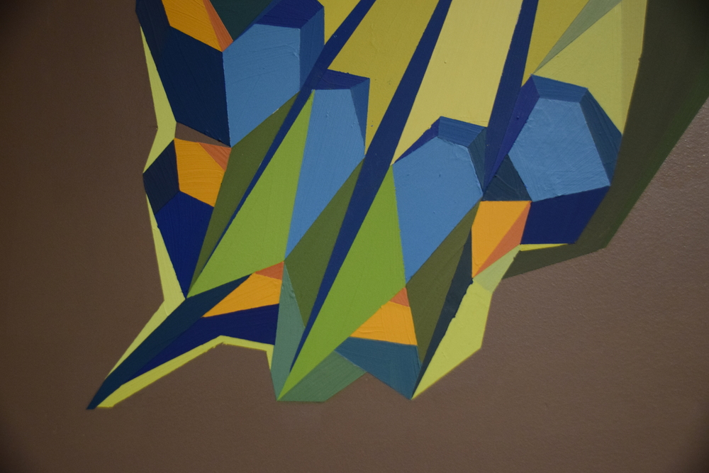 In this two-part mural using acrylic paint and die cut vinyl, completed in the fall of 2015 at Select Design, I expose the process behind my work. Each shape and its color are the result of very intentional decisions in order to produce all of this thought, sketching, and mathematics is often unknown. This piece shows the mark-making that exists throughout the entirety a mural. It intends to celebrate the work that goes into any creative process, not just mine.