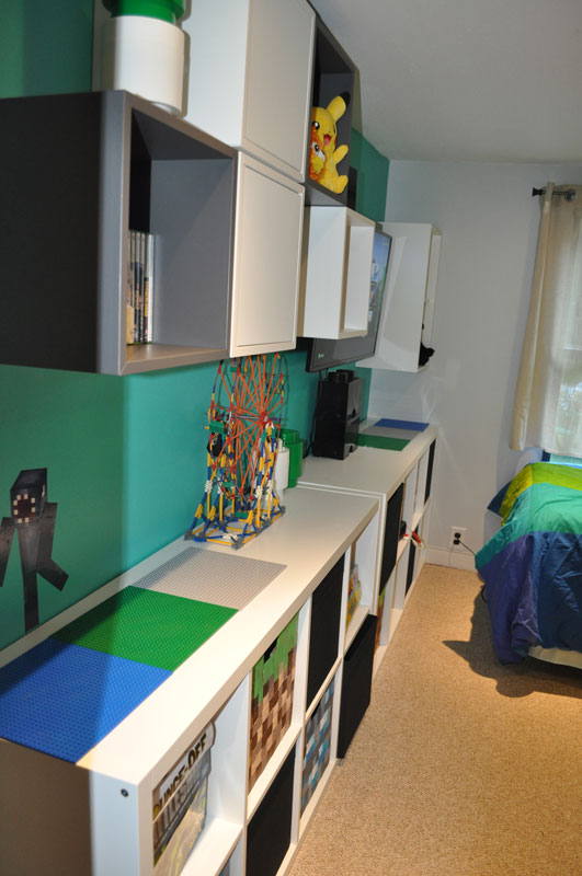 Seth can sit on the edge of his bed and play at his Lego Station with his new lego building plates