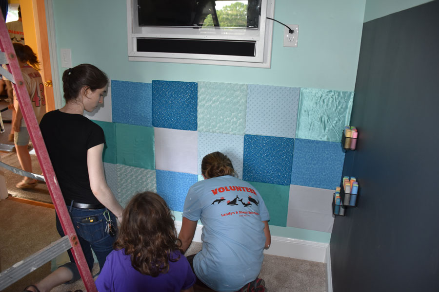 Julie and Alanna setting up the texture wall