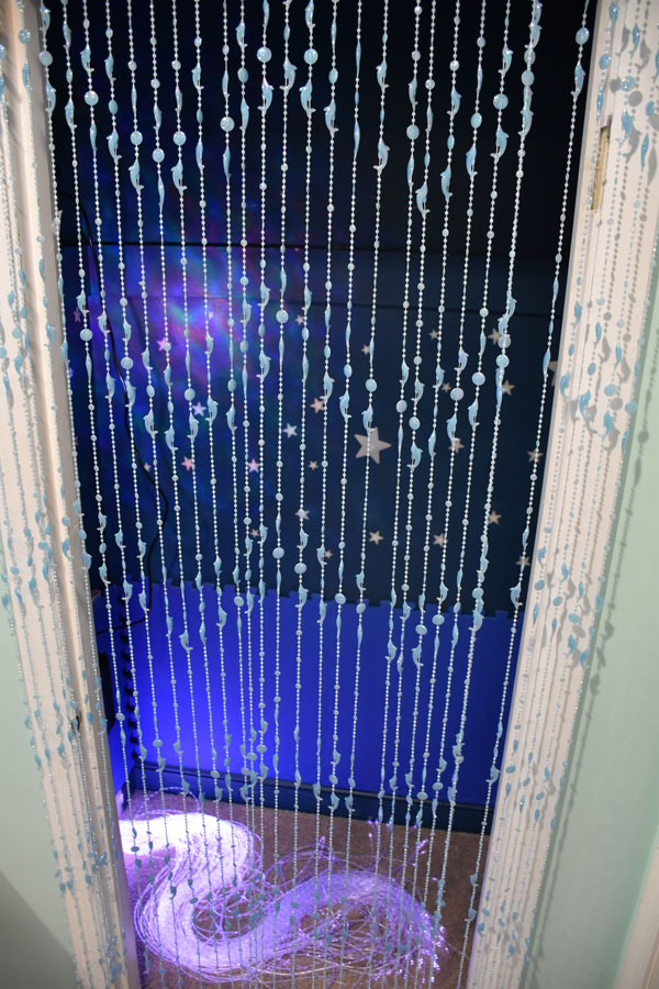 Light Sensory Zone featuring glow-n-the-dark dolphin beads, fiberoptic light strands, and ocean wave projector