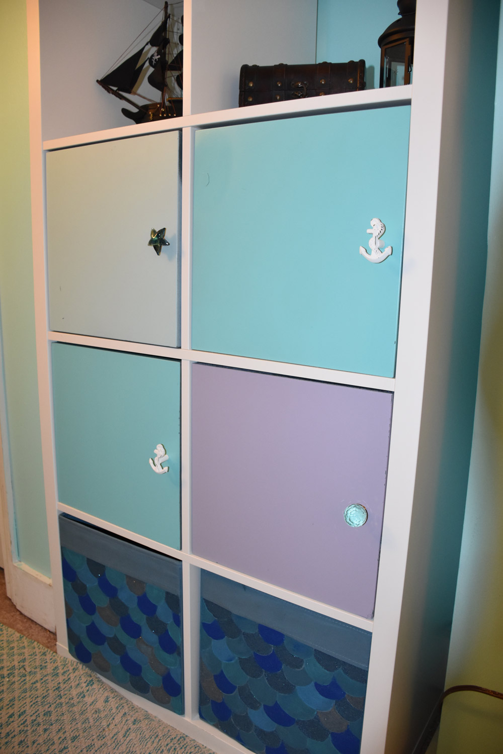 Hand-painted mermaid scaled storage bins and custom cabinet knobs
