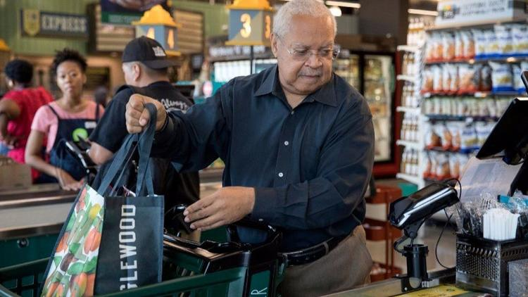 Addison Shields, 68, purchases groceries at the Englewood Whole Foods on Sept. 20, 2017, in Chicago. Shields took healthy cooking and eating classes at the store and says he was able to lose weight and reduce his blood sugar levels.    (Erin Hooley / Chicago Tribune)