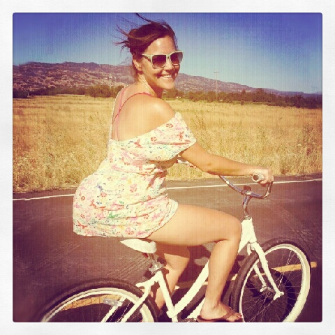 Lauren rides a bike in Napa.