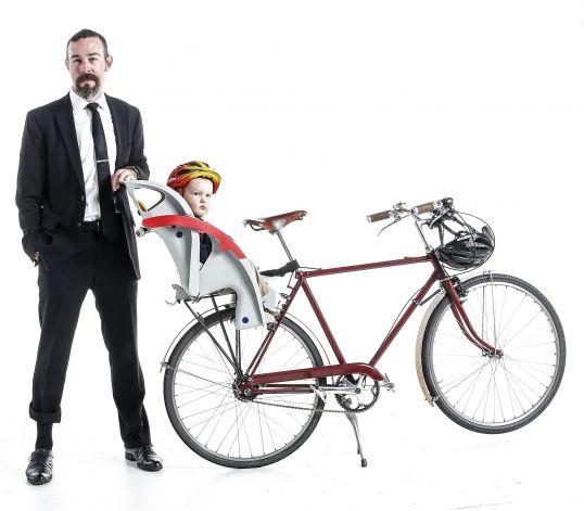 Dad bikes in a suit