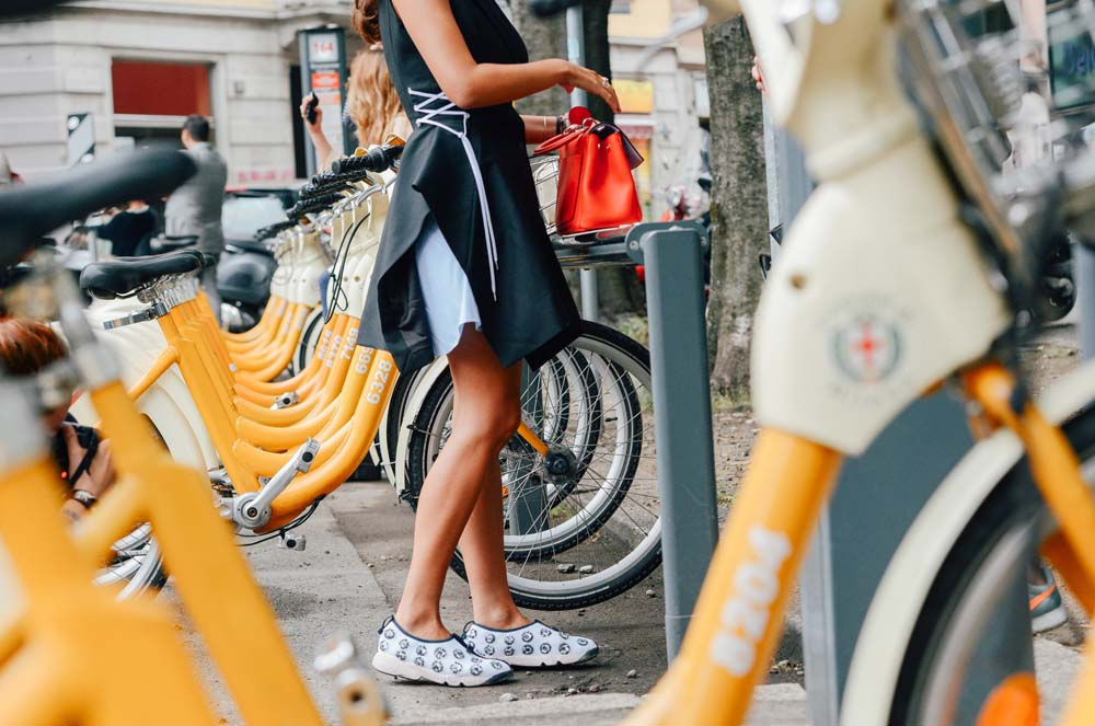 ...and she just returned hers to the docking station.  Raf Simons' Dior perfectly matches the Milan bikeshare.  Photo: Tommy Ton for Style.com, (Milan).