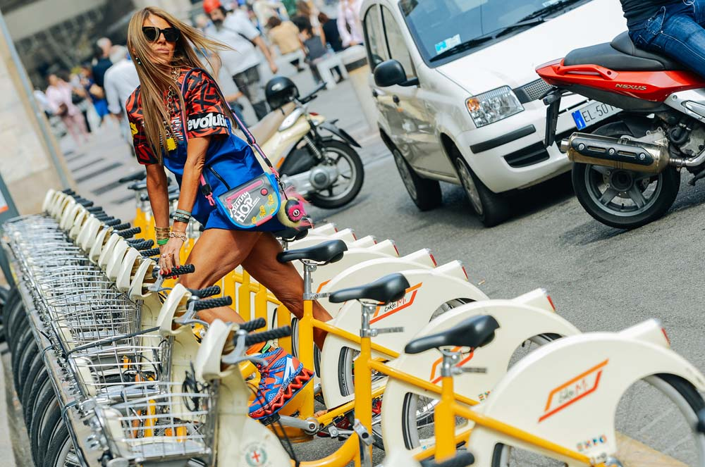 ADR proves she's got the hamstrings to bunny-hop on the bike-share. In head-to-toe MBMJ.  Photo: Tommy Ton for Style.com, Milan.