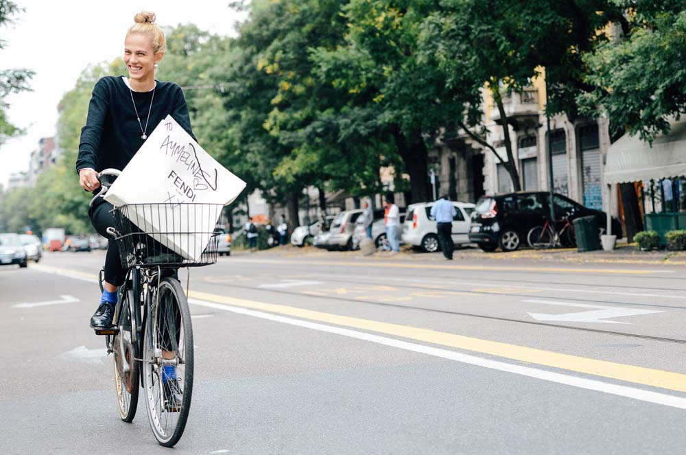 French model Aymeline Valade cycles to her next runway gig in style. With the love of Fendi, apparently.  Photo: Tommy Ton for Style.com, Milan.