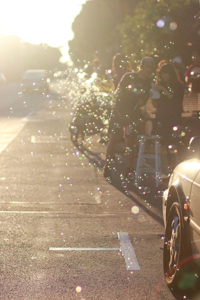 Biking through bubbles on Haight Street in San Francisco
