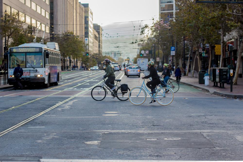 Bike commuter crossing Market Street in San Francisco