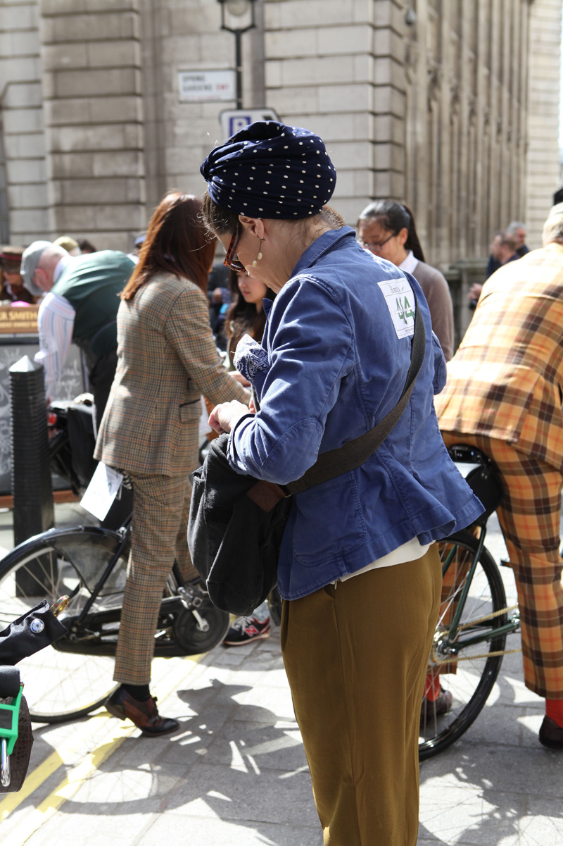 The couple that wears checked suits on bikes together...stays together (? we think so). Also: polka dot TURBAN.