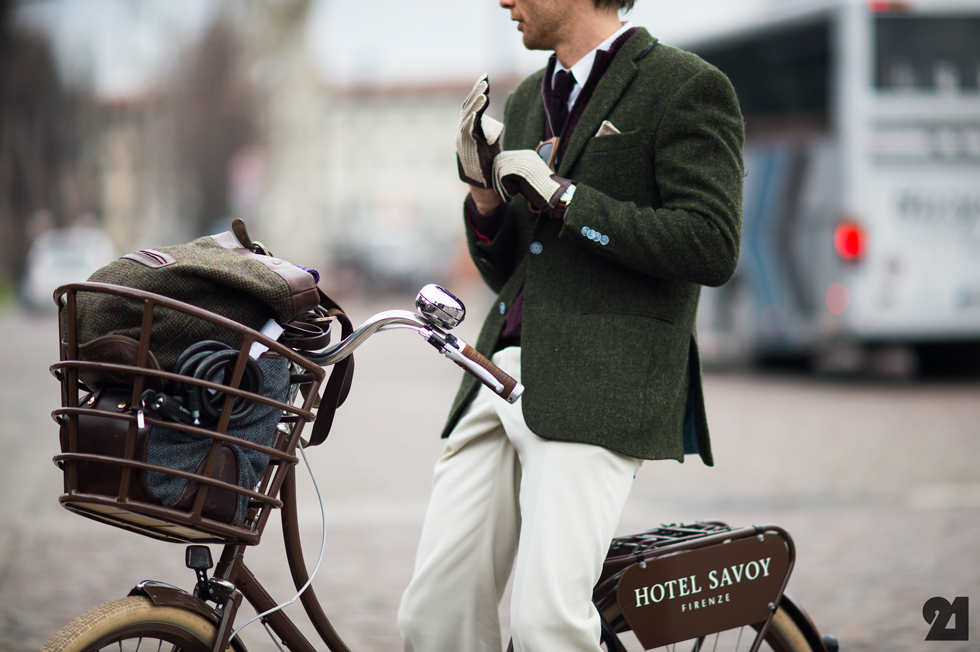 A stylish man rides a bike from the Hotel Savoy in Florence, photo via Le21eme.com