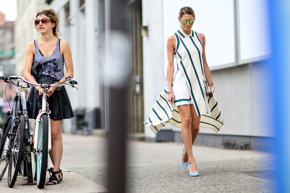 A cycle chic bystander is caught in the street style shooting during NYFW SS16. Photo via PopSugar.com