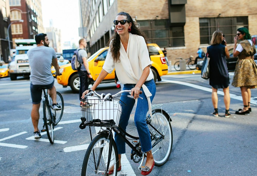 Stylist Stella Greenspan rides her bike through Manhattan during New York Fashion Week. Photo by Phil Oh for Vogue.com