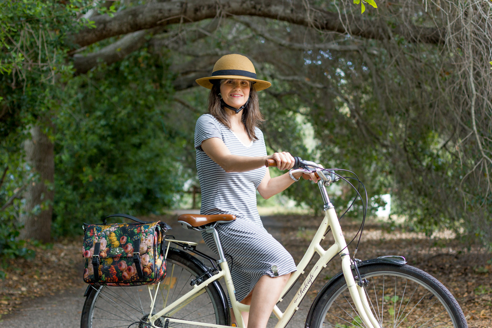 Mom keeps her dress from flying up with her Tandem NY Skirt Weight. Very useful for biking prettily!