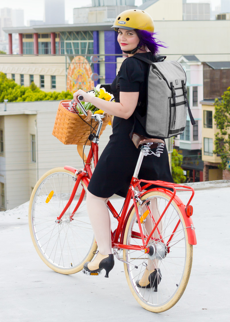 Gold Sparkle Nutcase Helmet | Rickshaw Bags Tweed Backpack | Puff-Sleeve Vintage Inspired Dress | Seamed Tights | Fluevog Two-tone High Heel Oxfords | Papillionaire Step-through Bicycle | Peterboro Basket with Liner