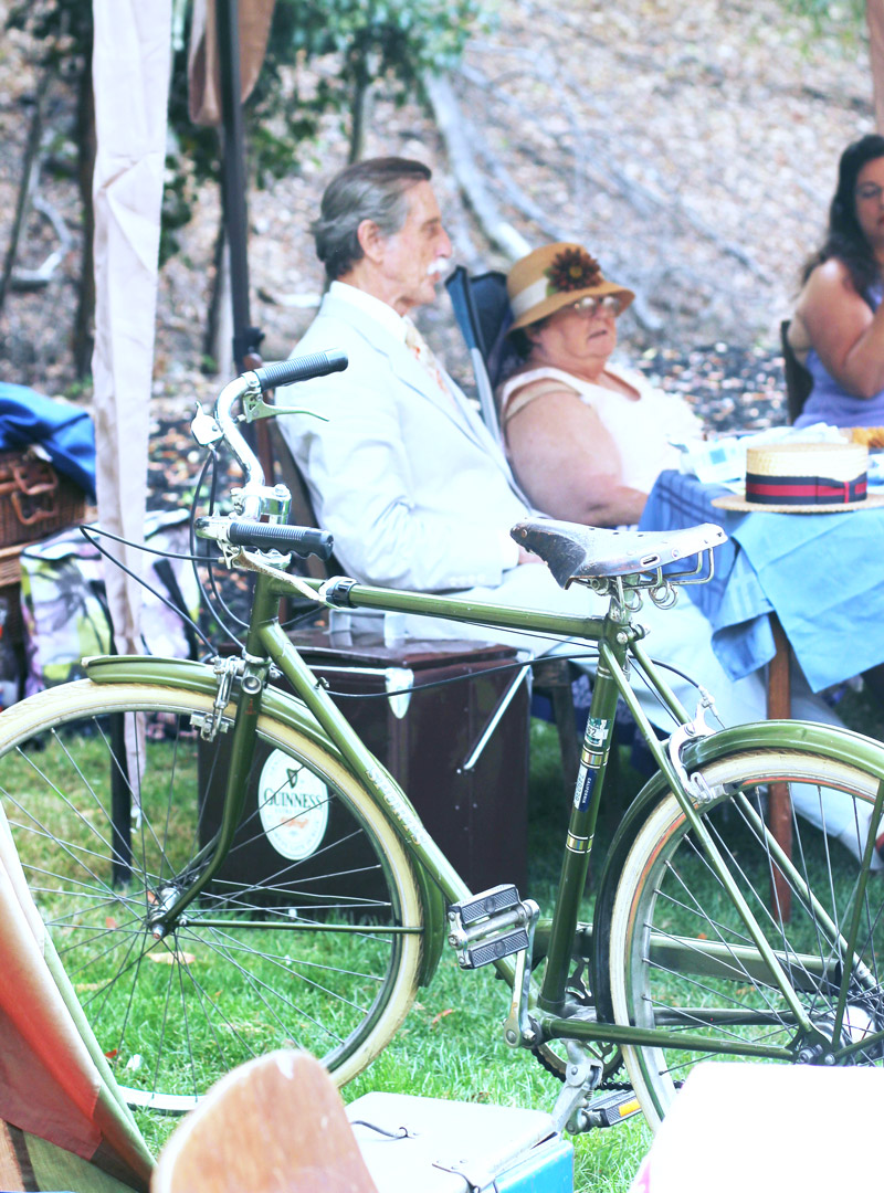 In addition to vintage fashion, elaborate picnic pavilions are encouraged. Vintage bicycles are often featured as part of the total look.