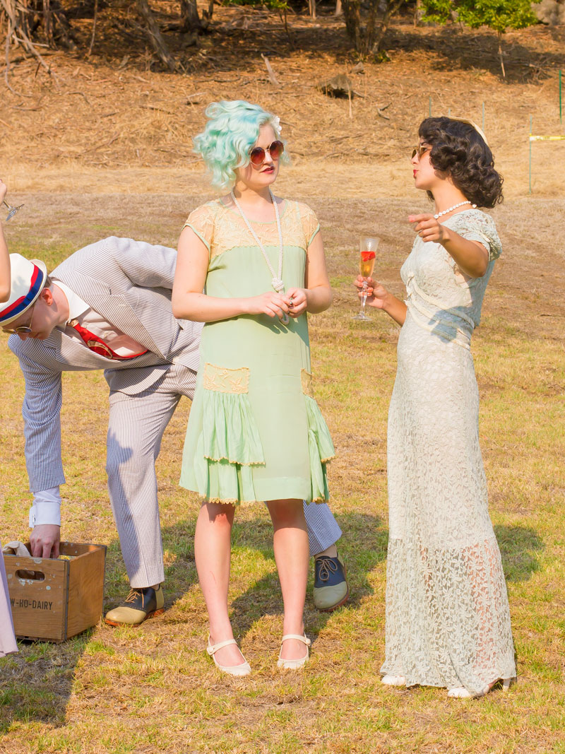 Turns out that pastel hair is  not  an anachronism! Click this link to learn more:   Pastel hair seems so new, but is so vintage...   In any case, both of these ladies look incredibly gorgeous. (We see you too, dapper seersucker dude!)