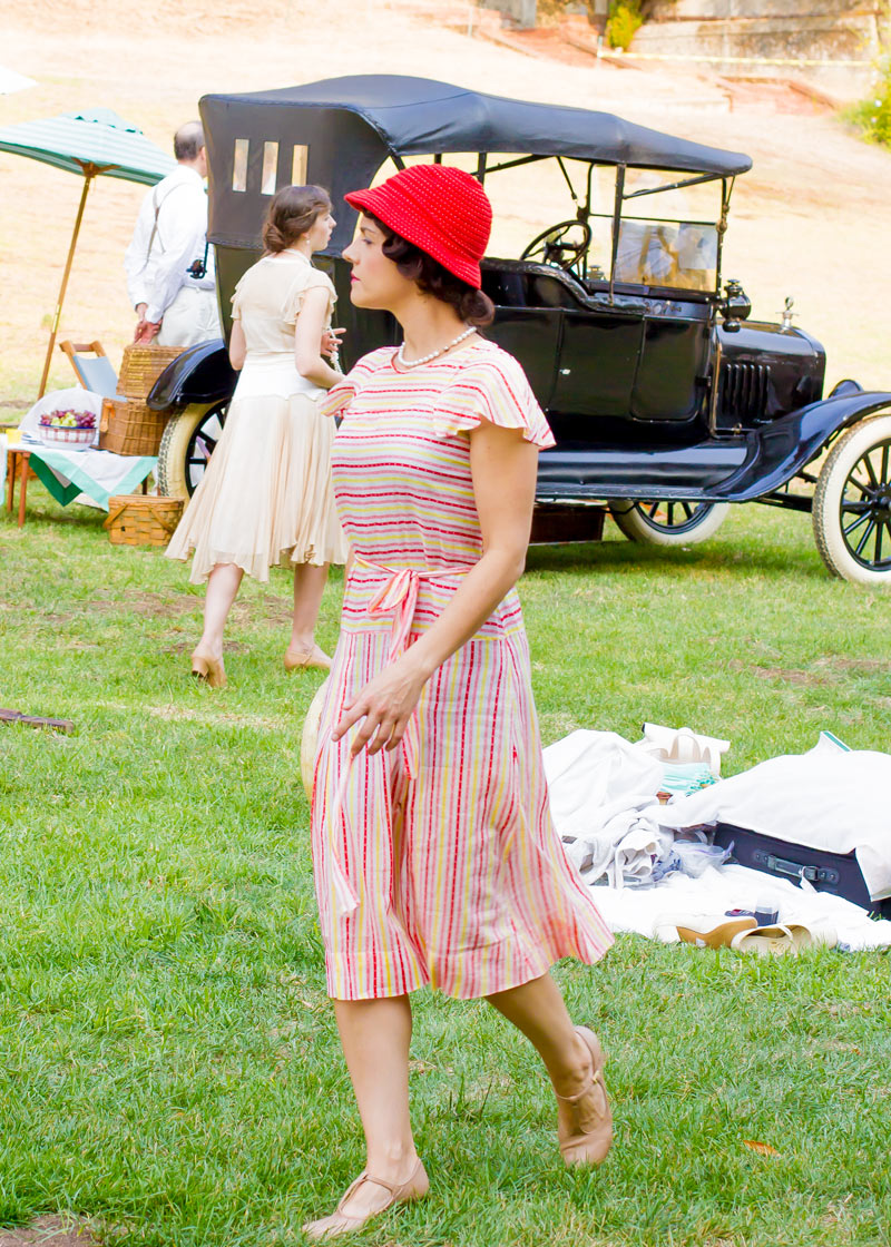 This dress is very similar to the one above, but you can see the influence of the 1930s look in the frilly cap sleeves and the slender ribbon at her natural waist.