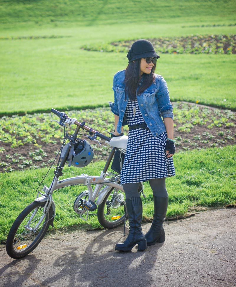 I'm getting early-90's vibes from her outfit, in the best possible way. Does anybody else see it? The folding bike is a smart choice for getting around the San Francisco Bay Area.